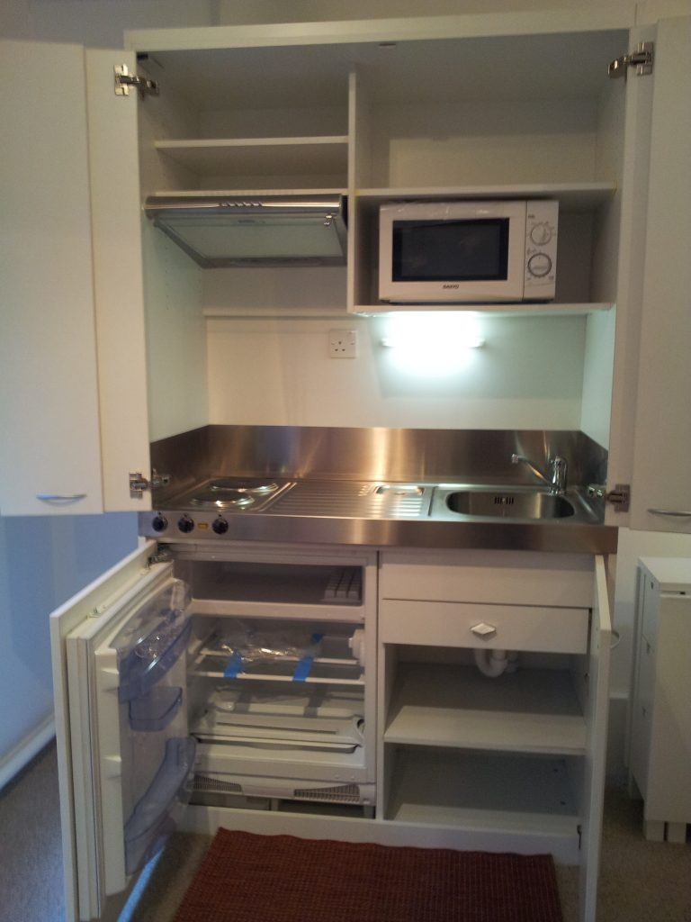 Everything, even the kitchen sink in this 1 metre wide concealed kitchen.